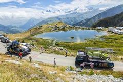 Bostik Caravan in Alps - Tour de France 2015. Col de la Croix de Fer, France - 25 July 2015: Bostik caravan driving on the road to the Col de la Croix de Fer in Royalty Free Stock Images