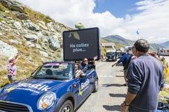 Bostik Caravan in Alps - Tour de France 2015. Col de la Croix de Fer, France - 25 July 2015: Bostik caravan driving on the road to the Col de la Croix de Fer in Stock Images
