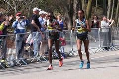 BOSTON - APRIL 18: Joyce Chepkirui (Kenya) and Tirfi Tsegaye (ETH) runners races up the Heartbreak Hill Royalty Free Stock Photography