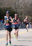 BOSTON - APRIL 18: male runners races up the Heartbreak Hill during the Boston Marathon April 18, 2016 in Boston. Lemi Berhanu Hayle of Ethiopia won the Royalty Free Stock Images