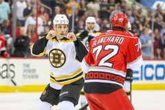 Boston Bruins center GREGORY CAMPBELL (11) and Carolina Hurricanes center NICOLAS BLANCHARD Stock Photography