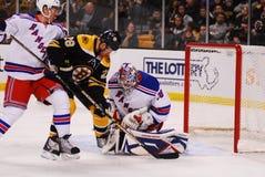 Mark Recchi and Henrik Lundqvist. Boston Bruins forward Mark Recchi moves in on Rangers goalie Henrik Lundqvist stock photography
