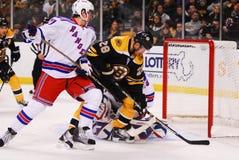 Mark Recchi and Henrik Lundqvist. Boston Bruins forward Mark Recchi moves in on Rangers goalie Henrik Lundqvist royalty free stock image