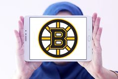Boston Bruins ice hockey team Club logo. Logo of Boston Bruins ice hockey team Club on samsung tablet holded by arab muslim woman. The Boston Bruins are a Royalty Free Stock Photo