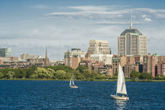 Boston Skyline from the Charles River. Charles River with sailing boats in front stock photo