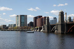 Boston city skyline. Scenic view of Boston city skyline with Longfellow bridge over Charles river in foreground and city of Cambridge, Massachusetts, U.S.A Royalty Free Stock Image