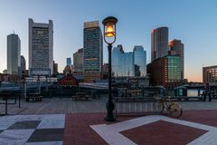 Boston city skyline tower and urban skyscrapers. With lamp in foreground stock photography