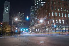 Boston city streets at night. Car trafic light trails Royalty Free Stock Images