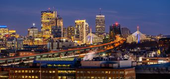 Boston Cityscape Panorama. Panoramic of Boston Cityscape with highway trail to Boston MA USA at night royalty free stock images