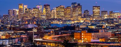 Boston Cityscape Panorama. Panoramic of Boston Cityscape with highway trail to Boston MA USA at night stock image