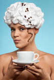 Boston coffee. A young lady in a whipped cream on her head with a coffee cup Stock Photo