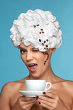 Boston coffee. A young lady in a whipped cream on her head with a coffee cup Stock Photos