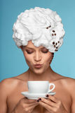 Boston coffee. A young lady in a whipped cream on her head with a coffee cup Royalty Free Stock Photos