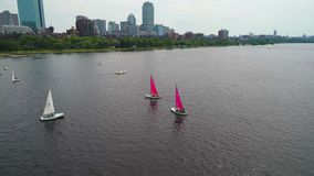 Boston community sailing 4k 60p active tracking spotlight mode drone aerial video stock footage