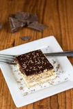 Boston Creme Pie Dessert. A layered Boston creme pie style dessert made with french vanilla filling and chocolate ganache topping Royalty Free Stock Photo
