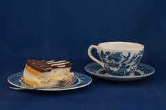 Boston Creme Pie And Tea. Here is a little taste of New England with some Boston Creme Pie and tea Royalty Free Stock Photo