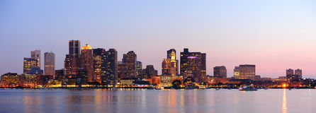 Boston downtown panorama at dusk. Boston downtown at dusk with urban buildings illuminated at dusk after sunset Stock Image
