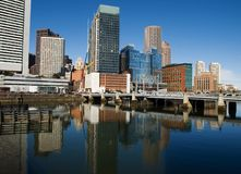 Boston downtown skyscrapers. And their water reflection during nice weather day. Clear blue sky Stock Photography