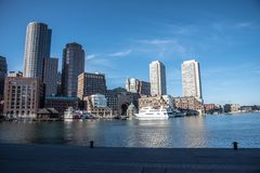 Boston financial district skyline from the Harborwalk. Boston funded in 1630, is one of the oldest cities in the United States royalty free stock photo