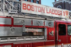 Boston Fire Department engine attend a call in the downtown area. Detail view of a Boston, MA fire truck seen moving away from its bay, attending an emergency Stock Images