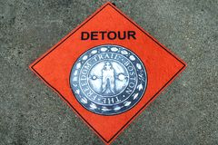 Boston Freedom trail detour new england. A orange detour sign for the Boston Freedom Trail in Massachusetts on a wall stock images