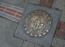Boston Freedom Trail Emblem. On sidewalk with bricks leading in different directions Stock Images