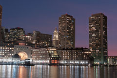 Boston Harbor and Financial District at night Stock Photo