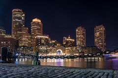 Boston Harbor and Financial District skyline at night - Boston, Massachusetts, USA Stock Photo