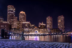 Boston Harbor and Financial District skyline at night - Boston, Massachusetts, USA Stock Images