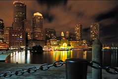 Boston Harbor at Night. Looking back towards Boston fronm Rowe's Wharf at night with the city lighting up the sky Stock Image