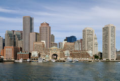 Boston Harbor and Skyline. Boston harbor and cityscape. Skyline of downtown district office and apartment buildings on the waterfront Stock Images