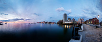 Boston harbor sunrise panorama. Boston harbor, Rowe's Wharf and the waterfront at sunrise Stock Photo