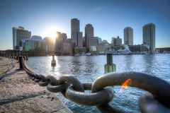 Boston Harborwalk. A view of the Boston skyline over the Fort Point Channel from the Courthouse Docks next to the Harborwalk in the Seaport District Royalty Free Stock Photo