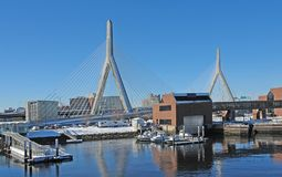 Boston harbour in sunny ambiance. Some boats anchoring in Boston (Massachusetts, USA) at winter time Stock Photos