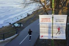 Runner running along Charles River Stock Image