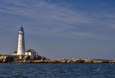 Boston Lighthouse. Historic Boston Lighthouse on Little Brewster Island on the left with more of the rocky island on the right Royalty Free Stock Photography