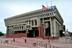Boston, MA: Boston City Hall. The austere, controversial, modernist Boston City Hall with its expansive brick plaza and historic Fanueil Hall (at right) in royalty free stock photography