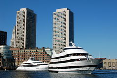 Boston, MA: Rowes Wharf & Boats. Two Spirit of Boston sightseeing ships at Rowes Wharf with two hulking modern towers and, on the left, the enduring landmark Stock Photography