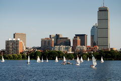 Boston, MA: Skyline and Charles River Sailboats. Small sailboats with their white sails dot the Charles River in front of the Boston skyline with the 52 story Stock Photos