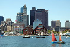 Boston, MA: Skyline and Harbour. Sailboats dot the waters of Boston harbour in front of the downtown financial district skyline with the famed Custom House Tower Royalty Free Stock Image