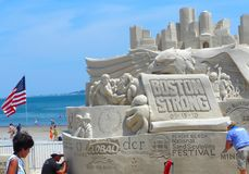 Boston, MA/USA-July 19 2013-The theme. `Boston Strong` in Revere Beach National Sand Sculpting Festival Royalty Free Stock Images