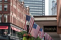 Boston, MA USA 06.09.2017 - Macy`s Shopping Mall Store with people walking and american flag waving. Boston, MA USA 06.09.2017 Macy`s Shopping Mall Store with Stock Photos