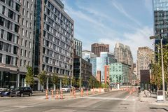 Boston MA USA skyline summer day panoramic view buildings downtown and road with traffic at waterfront side. Boston MA USA skyline in summer day, panoramic view royalty free stock image