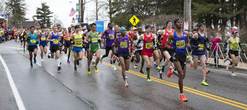 Boston Marathon 2015. Athletes competing in the Boston Marathon 2015 a few minutes after the start of the competition in Hopkinton, MA, USA Royalty Free Stock Images