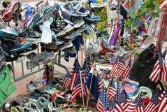 Boston Marathon bombing memorial. Spontaneous memorial of shoes, caps, t-shirts, sign after Boston Marathon bombing Royalty Free Stock Photography