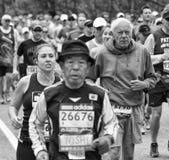 Boston Marathon 2013. Elderly athletes competing at the Boston Marathon 2013 on their way from Hopkinton to Boston in Massachusetts, USA fast and steadily on Royalty Free Stock Photo