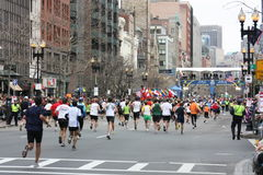 The Boston Marathon Finish Line. Runners head toward the finish line at the Boston Marathon Royalty Free Stock Photography