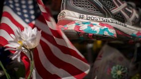 Boston Marathon Memorial. A makeshift memorial of flowers, flags, notes and running shoes for the victims of the Boston Marathon Bombing Stock Photography