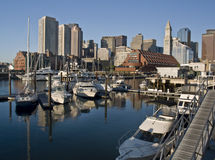 Boston Maritime District. View of the downtown of Boston (USA) from a pier of the maritime district, with some boats on the foreground and the skyline of the Royalty Free Stock Photo