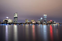Boston Massachusets Downtown Skyline at Night. The Boston Massachusetts skyline at night reflected on the water Stock Photography